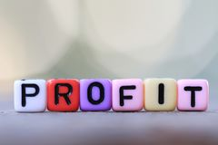Textbox of Profit and green blur bokeh background. Stock Photo