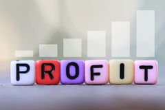 Textbox of Profit and green blur bokeh background. Royalty Free Stock Photos