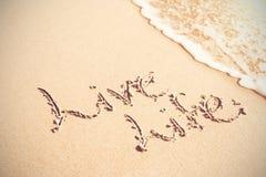 Texte écrit de la vie vivante sur le sable Photo libre de droits