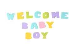 Texte bienvenu de bébé garçon sur le fond blanc Image libre de droits