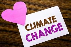 Texte conceptuel d'écriture de main montrant le changement climatique Concept pour le chauffage global de planète écrit sur le pa Image libre de droits