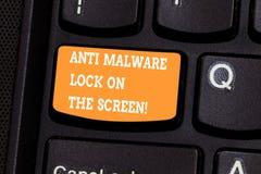 Texte d'écriture écrivant l'anti serrure de Malware sur l'écran Concept signifiant la sécurité de sécurité contre entailler de ma photo stock