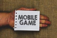 Texte d'écriture écrivant le jeu mobile Signification de concept ils sont des programmes amusants faits fonctionner sur la partic photos stock