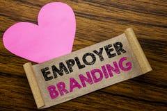 Texte d'écriture montrant le marquage à chaud d'employeur Concept d'affaires pour le bâtiment de marque écrit sur le papier de no Image stock