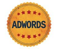 Texte d'ADWORDS, sur le timbre d'autocollant de jaune de vintage Image stock