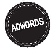 Texte d'ADWORDS, sur le timbre noir d'autocollant Photos stock