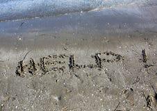 Texte d'AIDE sur le sable Photo libre de droits