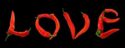 Texte d'amour composé de poivrons de piment rouge Images stock