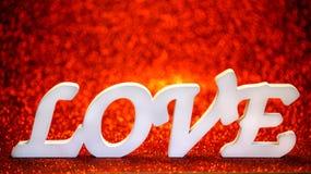 Texte d'amour sur le fond rouge brillant Photographie stock