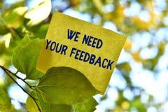 Texte d'?criture de Word nous avons besoin de votre r?troaction Le concept d'affaires pour la critique donnée pour dire peut être image stock