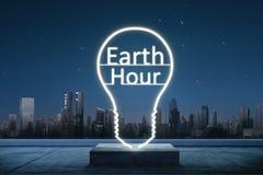 Texte d'heure de la terre à l'intérieur d'ampoule photos libres de droits