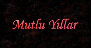 Texte de bonne année dans le turc Mutlu Y ? llar sur le backgroun noir Images stock
