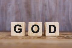Texte de Dieu sur les blocs en bois Images libres de droits