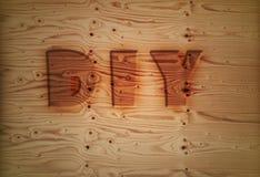 Texte de Diy sur la planche en bois Photographie stock libre de droits