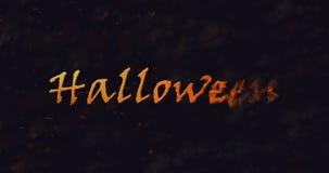Texte de Halloween se dissolvant dans la poussière vers la droite Photographie stock libre de droits