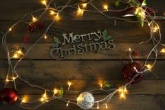 Texte de Joyeux Noël avec des lumières de Noël images stock