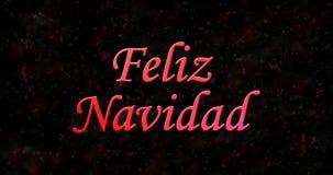 Texte de Joyeux Noël dans l'Espagnol Feliz Navidad sur le backgro noir Photographie stock libre de droits