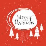 Texte de Joyeux Noël sur un fond d'hiver Photos libres de droits