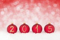 Texte de la nouvelle année 2015 sur des babioles de Noël Photographie stock libre de droits