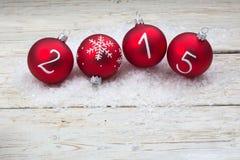 Texte de la nouvelle année 2015 sur des babioles de Noël Image stock