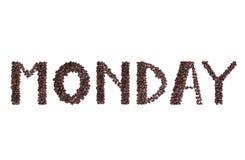 Texte de lundi fait à partir des grains de café bruns frais Photographie stock