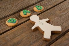 Texte de papa écrit sur des biscuits avec le pain d'épice Images libres de droits