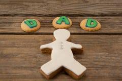 Texte de papa écrit sur des biscuits avec le pain d'épice Photo stock