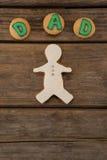 Texte de papa écrit sur des biscuits avec le pain d'épice Photos stock