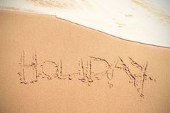 Texte de vacances sur le sable à la plage Photos libres de droits