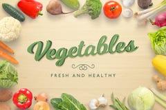 Texte des légumes 3D sur la table de cuisine en bois entourée avec les légumes frais du marché Photographie stock