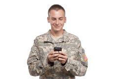 Soldat Texting Stockbild