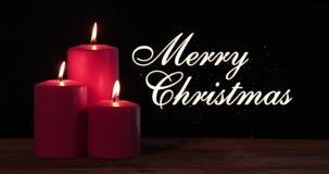 Texte et bougies de Joyeux Noël avec la lumière banque de vidéos