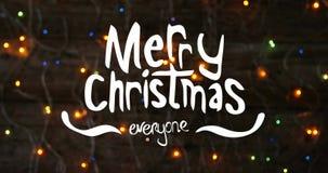 Texte et quirlandes électriques 4k de Joyeux Noël banque de vidéos