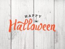 Texte heureux de Halloween au-dessus de fond en bois affligé photos stock