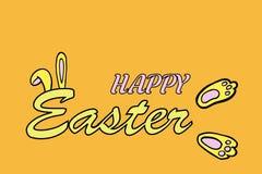 Texte heureux de Pâques avec des oreilles et des pieds de lapin sur l'orange illustration libre de droits
