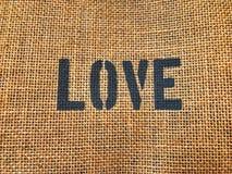 Texte noir d'amour sur le tissu de brun de vintage photo libre de droits
