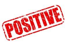Texte rouge positif de timbre Photographie stock