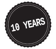 Texte 10-YEARS, sur le timbre noir d'autocollant Images stock
