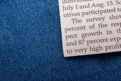 Texted paper  on a denim canvas Stock Image