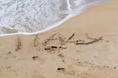 Texten på sand Fotografering för Bildbyråer
