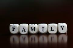 Textfamilien-Buchstabewürfel Lizenzfreies Stockbild