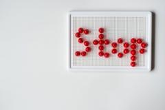 Texthalt umrissen mit Mosaiken Lizenzfreie Stockfotografie