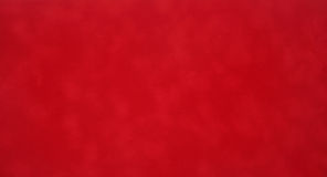 Textile. Red vibrant colored velvet fabric background Stock Photography