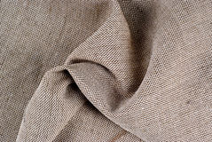Textile. Light-brown pock-marked textile Royalty Free Stock Image