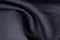 Textile. Dark-gray vawed textile, dark-silver jeans Royalty Free Stock Images