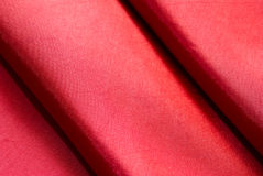 Textile background. Red textile background horizontal and close-up royalty free stock images