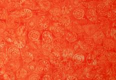 Textile background - Batik pattern. In yellow, red and orange Stock Photos