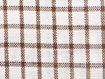 Textile background - brown checkered cotton fabric Royalty Free Stock Photo
