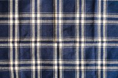 Textile background with a checkered blue napkin, top view. Natural textile background. Fabric texture background. Texture of natur. Al linen fabric stock photos
