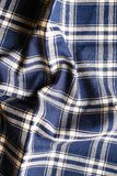 Textile background with a checkered blue napkin, top view. Natural textile background. Fabric texture background. Texture of natur. Al linen fabric royalty free stock images
